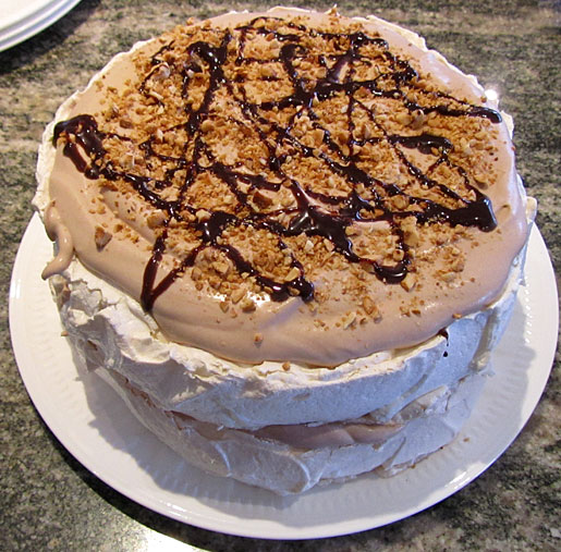 layered pavlova with chocolate cream