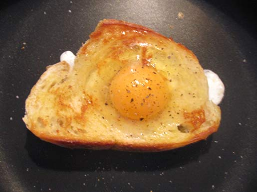 cooking an egg on toast