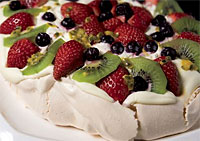 pavlova dessert filled with fruit and cream
