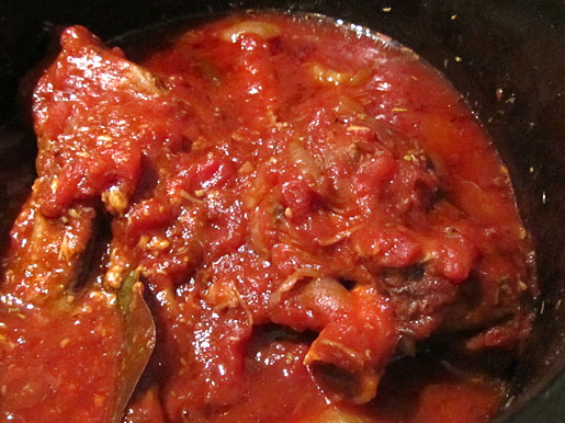 lamb shanks slow cooked with tomatoes and garlic