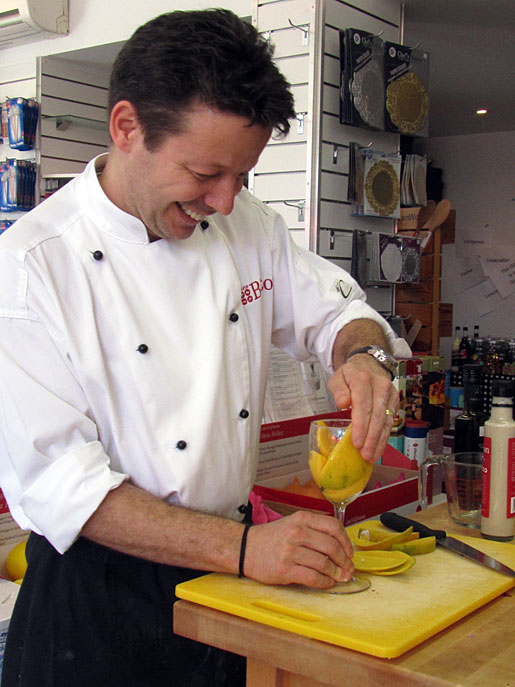 David Bitton peeling a mango