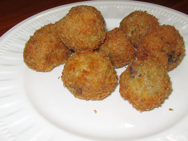 risotto balls stuffed with cream cheese