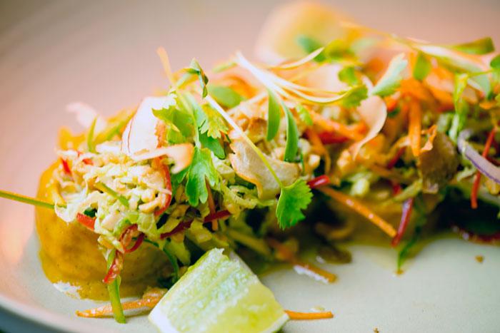 Mooloolaba Prawns with vegetable kottu, roasted coconut, peanuts and betel leaf