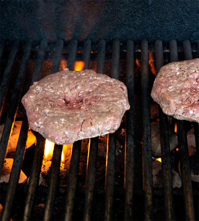beef patty on the grill