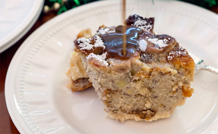Bread pudding from banana bread with dark toffee sauce